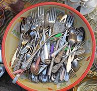 Ancient silverware cutlery in plate at flea market - stock photo