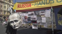 An Ukraine support spot in Prague with head of  Putin and a demon - stock footage