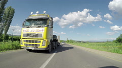 Overtaking truck on the road. Large delivery truck is moving Stock Footage