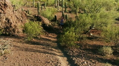Slow Motion Aerial Shot of Trail Runners in Arizona Sonoran Desert Stock Footage