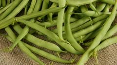 Asparagus beans on sackcloth. Stock Footage