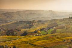 Elevated view of valleys and distant autumn vineyards, Langhe, Piedmont, Italy - stock photo