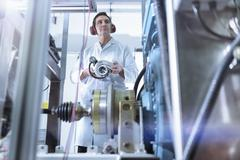 Scientist in turbo charger automotive research laboratory - stock photo