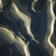 Overhead detail of patterns formed by ocean waves in sand Kuvituskuvat