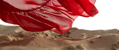 Red Dress flying in the Air in a Sand Desert in Slow Motion Close Shot Stock Footage
