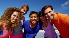 Portrait of multi ethnic college friends making video diary on the beach Stock Footage