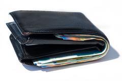 Stack of various of israeli shekel money bills in close black leather wallet - stock photo