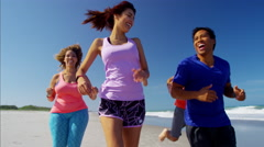 Healthy multi ethnic people running on the beach on college break Stock Footage