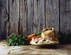 Carrots, coriander, mushrooms and pearl barley in burlap sack Stock Photos