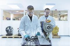 Scientists working in turbo charger automotive research laboratory - stock photo