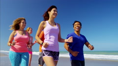 Young multi ethnic people enjoying their training for weightloss on the beach Stock Footage