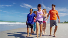 Active multi ethnic college friends keeping fit beside the ocean Stock Footage