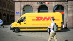 DHL van and HSBC branch in the center of the city Stock Footage