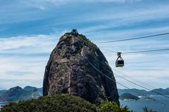 Low angle view of cable car attached to Sugarloaf mountain, Rio de Janeiro, - stock photo
