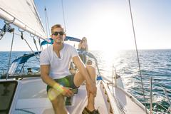 Man enjoying view on sailboat, San Diego Bay, California, USA Kuvituskuvat