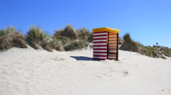 Dunes and traditional Baltic beach chair strandkorb Stock Footage