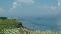 Coast View with Sailing Boats at Baltic Sea, Schönhagen Beach (Ostsee) - stock footage