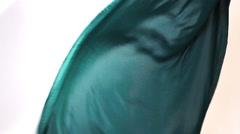 Dark green blue fabric flows on an air Stock Footage