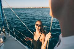 Woman chatting with friend on sailboat, San Diego Bay, California, USA Kuvituskuvat