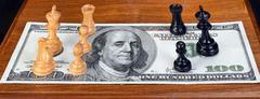 Chess and Money. Stock Photos