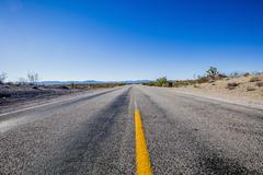 Straight endless road Through Desert photographed near Primm on the Nevada, - stock photo