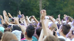 Cheering fan spectators crowd people by concert stage dancing enjoying a music - stock footage