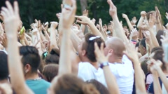 Cheering fan spectators crowd people by concert stage dancing enjoying a music Stock Footage
