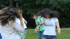 Teen age girls fans dancing enjoying music concert in a park festival Stock Footage