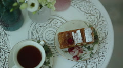 Tea and a piece of cake on vintage china sets Stock Footage