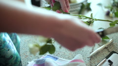 Florist prepares flowers for a floral composition Stock Footage