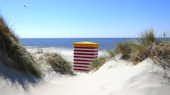 Dunes and a traditional Baltic beach chair strandkorb Stock Footage