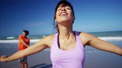 Portrait of Latin American female enjoying training on the beach Stock Footage
