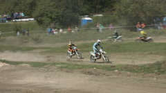Extreme Jumps and Stunts on Motorbikes by Motokrossers During Off-Road Racing. Stock Footage