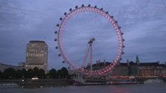 London Eye wheel lights Thames river view City building lights in the evening. Stock Footage