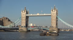 Traffic cars and double decker red bus crossing Tower bridge over Thames river. Stock Footage