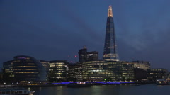 Night London view boat sailing Thames river downtown financial center lighted. Stock Footage