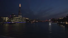 London tourist center nightscape buildings lights reflected in Thames river. Stock Footage