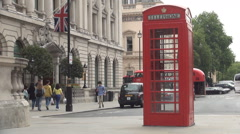 Telephone red cab London symbol on Westminster street. Stock Footage