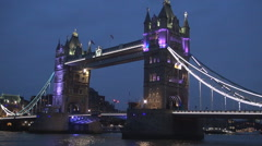 London Bridge with colored lights night view image in downtown London city. Stock Footage