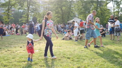 Family mother with kid walk rest on park picnic festival waiting for open air Stock Footage