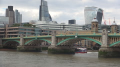 Ship sailing on Thames river under Southwark Bridge downtown skyscrapers image. Stock Footage