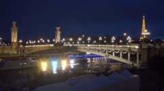 Tourist ships lighted sail under Alexander III bridge night in Paris time-lapse. Stock Footage
