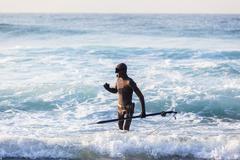 Diver Spear Gun Beach Ocean - stock photo