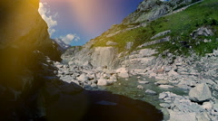 Flying over epic stone rocks in mountain river. aerial view scenery Stock Footage
