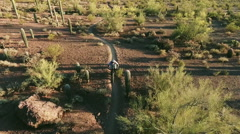 Slow Motion Aerial Shot of Biker on Southwestern Desert Trail - stock footage