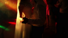 Bride and groom dance in the spotlight. Slow mo Stock Footage