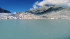 Flying over melting ice floe. glacier lake panorama. mountain alps Stock Footage