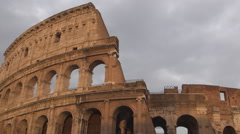 Rome sightseeing Colosseum amphitheater ancient monument walls in a cloudy day. Stock Footage
