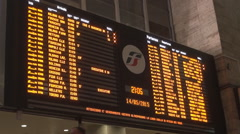 Rail station electronic table arrivals and departures train schedule in Rome. Stock Footage