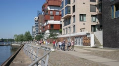 Waterfront with modern appartments in Hamburg Hafencity Kaiserkai in daylight Stock Footage